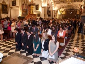 Confirmaciones de jóvenes universitarios en la iglesia de los Santos Justo y Pastor.